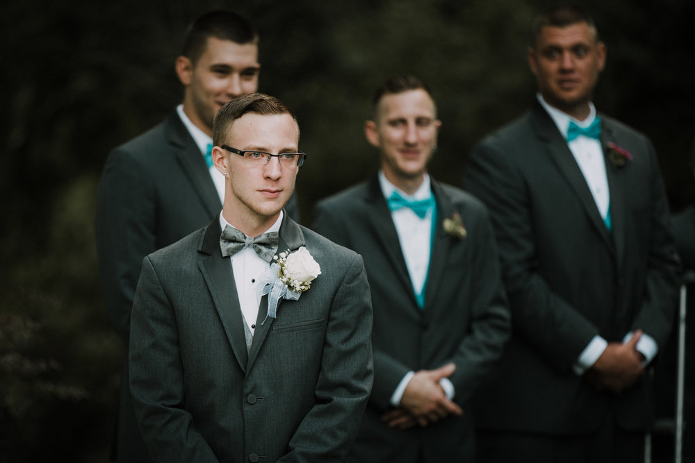 groom_reaction_bride_aisle_tears_joy_blue_suit_white_boutonnaire_adventure_outdoors_trees_dress_outdoors_connecticut_rhode_island_massachusetts_new_england_wedding_photography_photographer_natural_laid_back_fun_light_engagement_session.jpg