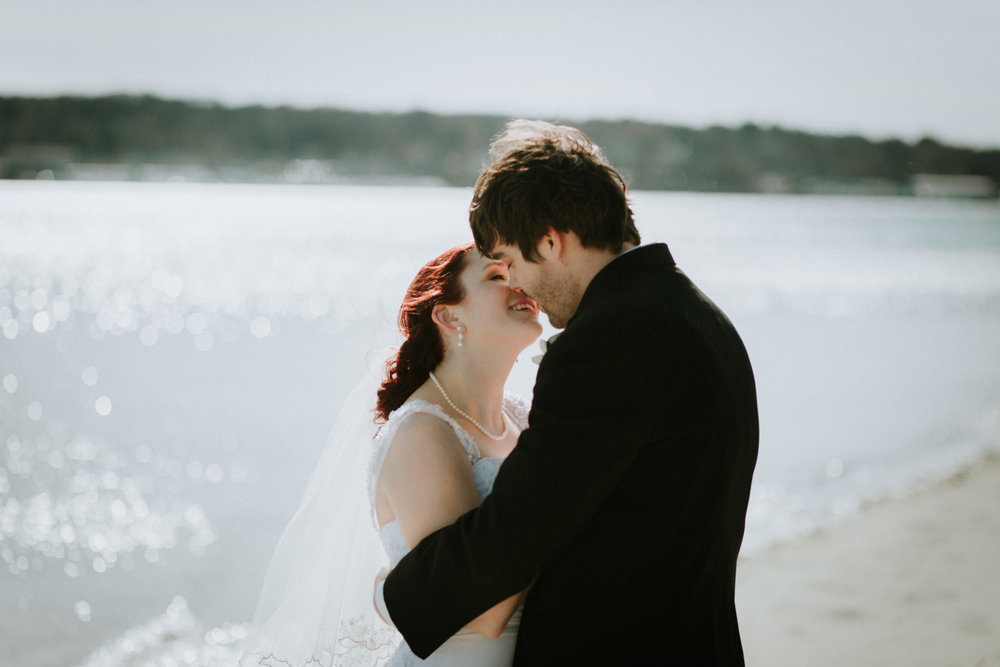 kiss_married_red_hair_april_spring_earrings_beach_water_kissadventure_outdoors_trees_dress_outdoors_connecticut_rhode_island_massachusetts_new_england_wedding_photography_photographer_natural_laid_back_fun_light_engagement_session.jpg