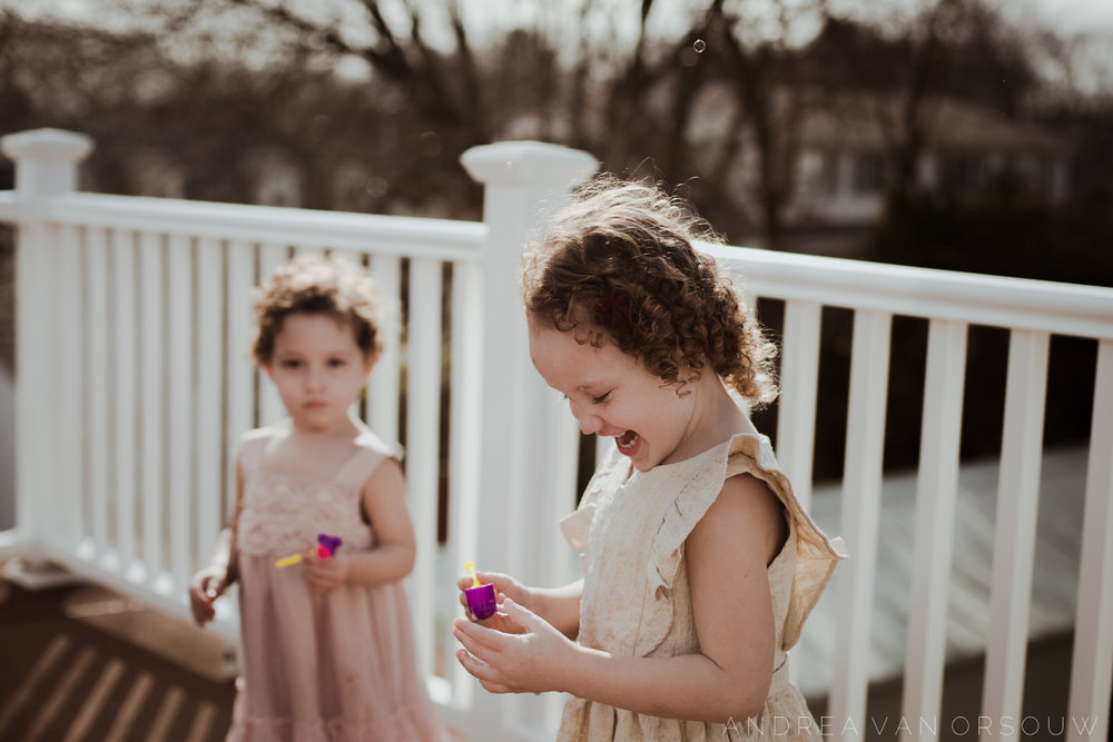 bubbles_outside_porch_lifestyle_session_fun_spring_new_england_wedding_photographer.jpg