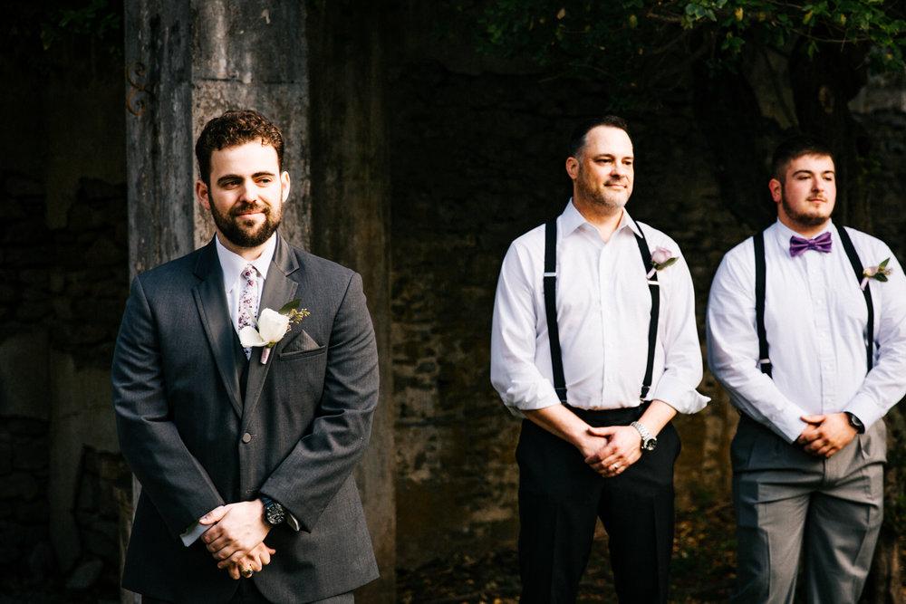 first-look-wedding-ceremony-gwyn-careg-inn-pomfret-connecticut-new-england-groom-groomsmen.jpg
