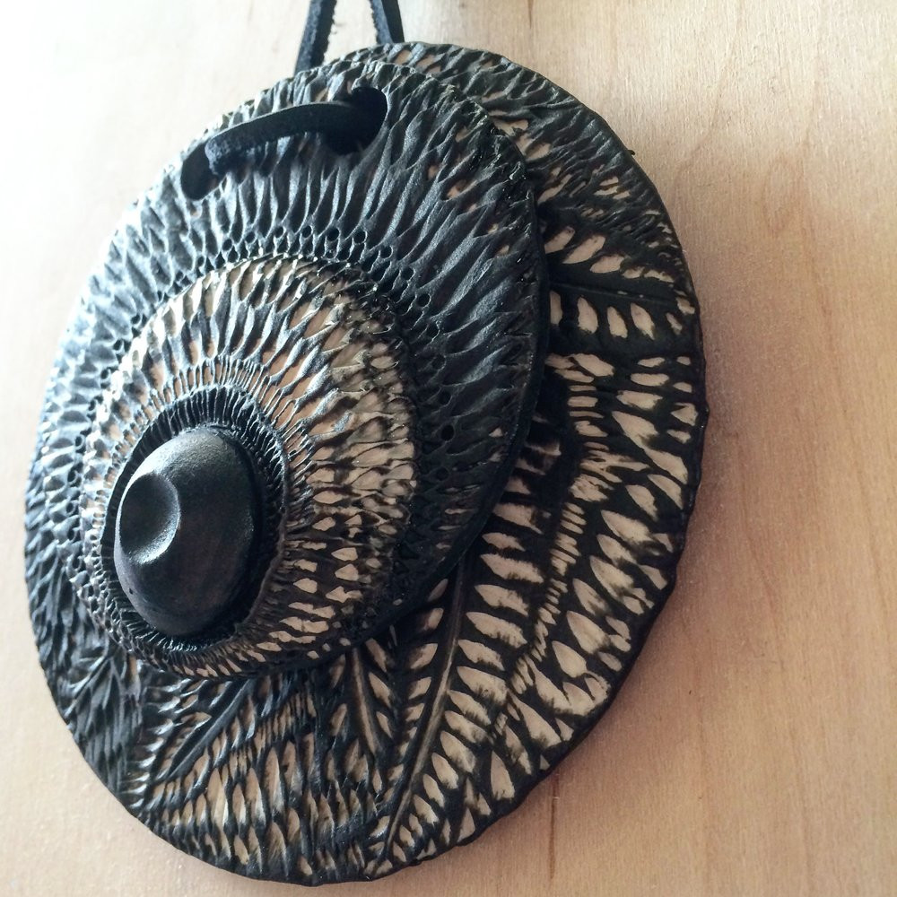 HOUSE JEWELRY - BLACK AND WHITE TEXTURED PORCELAIN WITH LEATHER