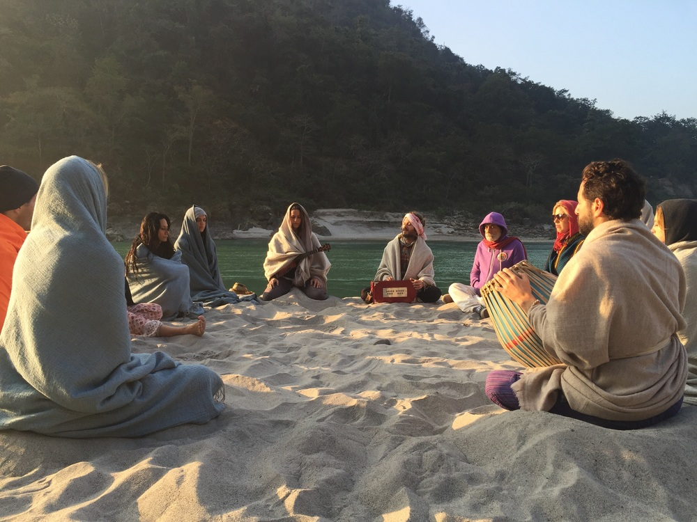 Morning kirtan with bhakti yoga shala group at the ganges river in rishikesh, india