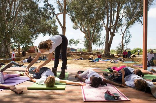 OM Matters at a yoga event for at-risk youth, a cause close to Tambra's heart