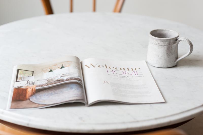 white_rustic_mug_and_open_magazine