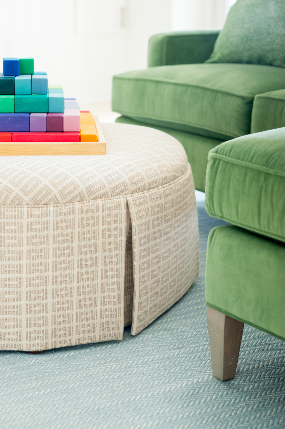 close_up_of_green_couch_and_blocks