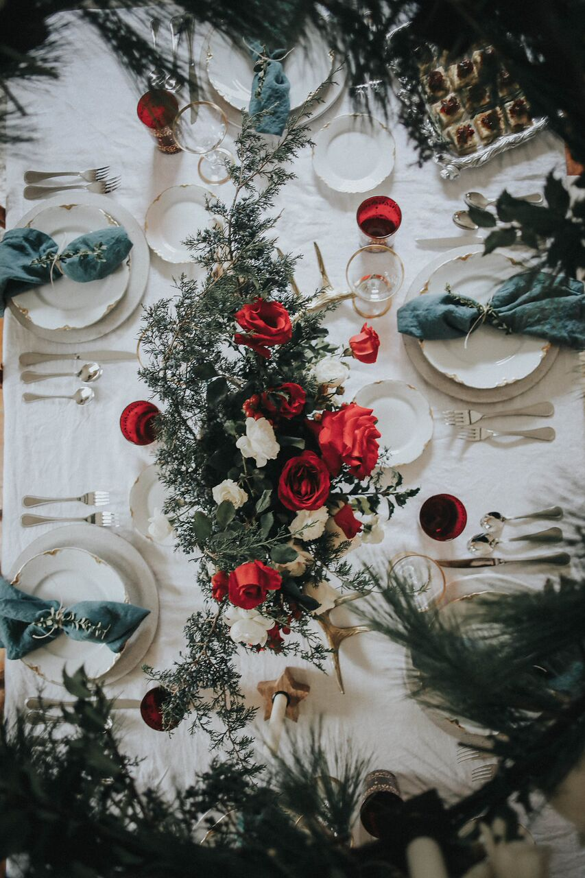 Holiday-Party- Scandanavian-table-decor-red-white-evergreens-cottage-rose