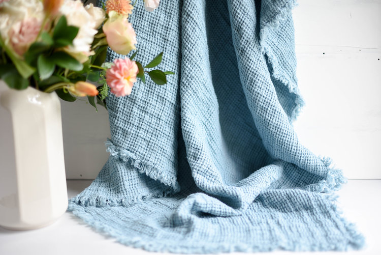 Whatever the weather where they live, everyone on your list will love our  Washed Linen Throw . It's just right for a touch of warmth by the fire or for a breezy summer evening on the patio. Choose from Blue or Grey.