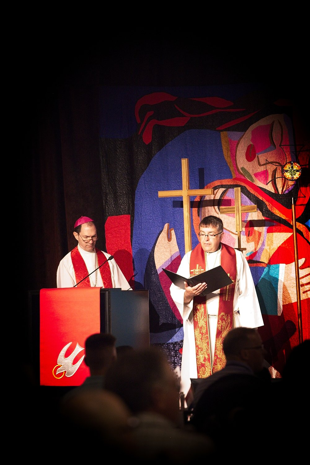 The Catholic Bishop and Lutheran Bishop, leading a service, together.