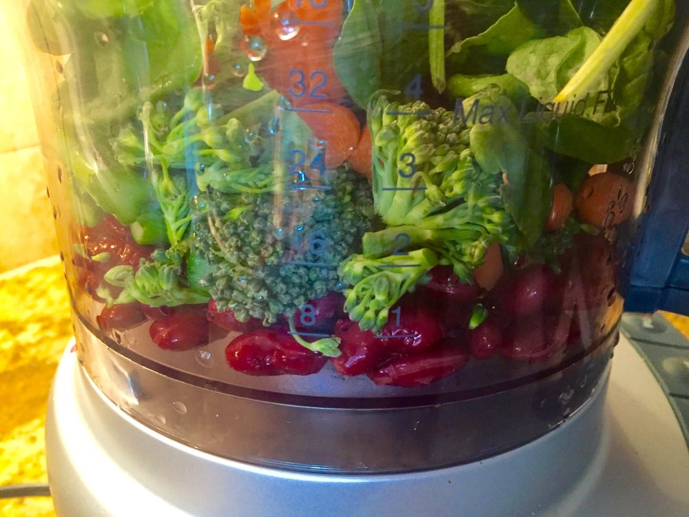 Add black beans to the vegetables in food processor and mix well.