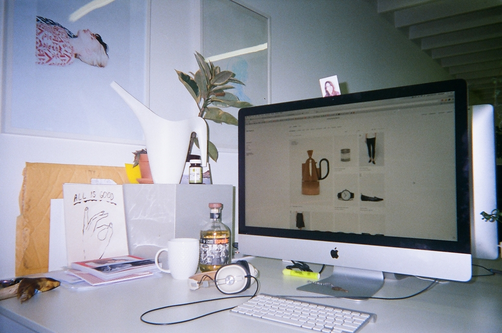 This is my desk at my job at Need Supply Co. Furnished with all the findings of a modern office such as: an old banana, a newly opened bottle of Espolón, and a bookmark with Ana Kraš wearing a goofy expression taped to my iMac!