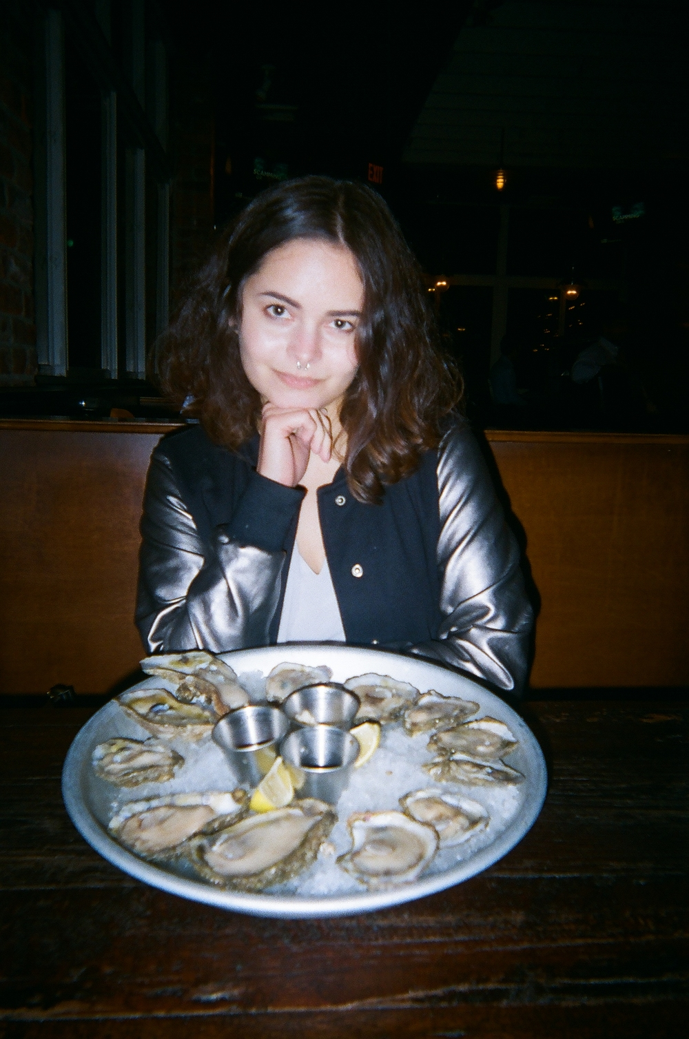 It me! With my favorite food, OYSTERS! I only started eating them last year, but seafood has been a part of my life since I was a beeb. I grew up 15 minutes away from the Atlantic ocean. Shoutout to that jacket—it's a favorite of mine.