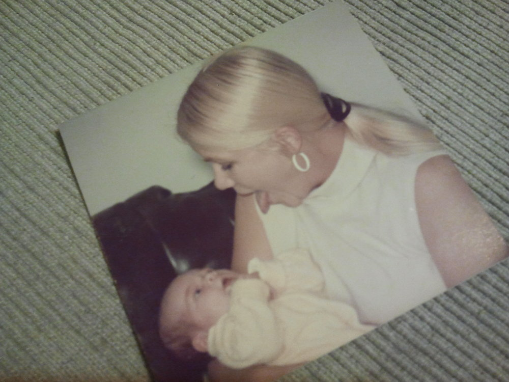 Baby Diana with her adoptive mother on the day she was officially adopted.