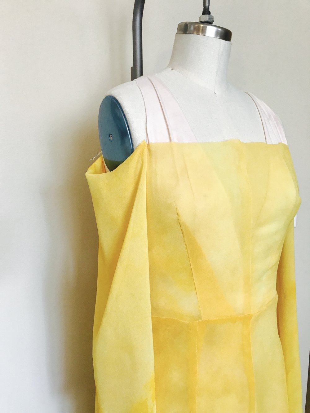 Hand dyed silk chiffon off-the-shoulder dress, yellow color created using yellow onion skins