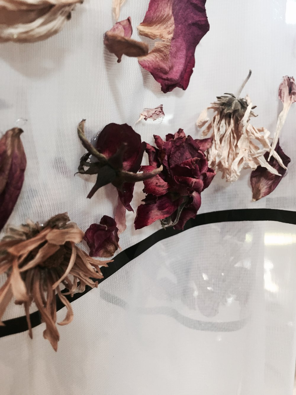 Dried flower detailing on a sheer skirt