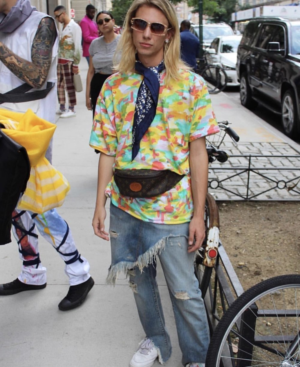 Christopher Di Giorgio wearing a tie dye camoflauge t-shirt from his SS18 collection during NYFWM in July.