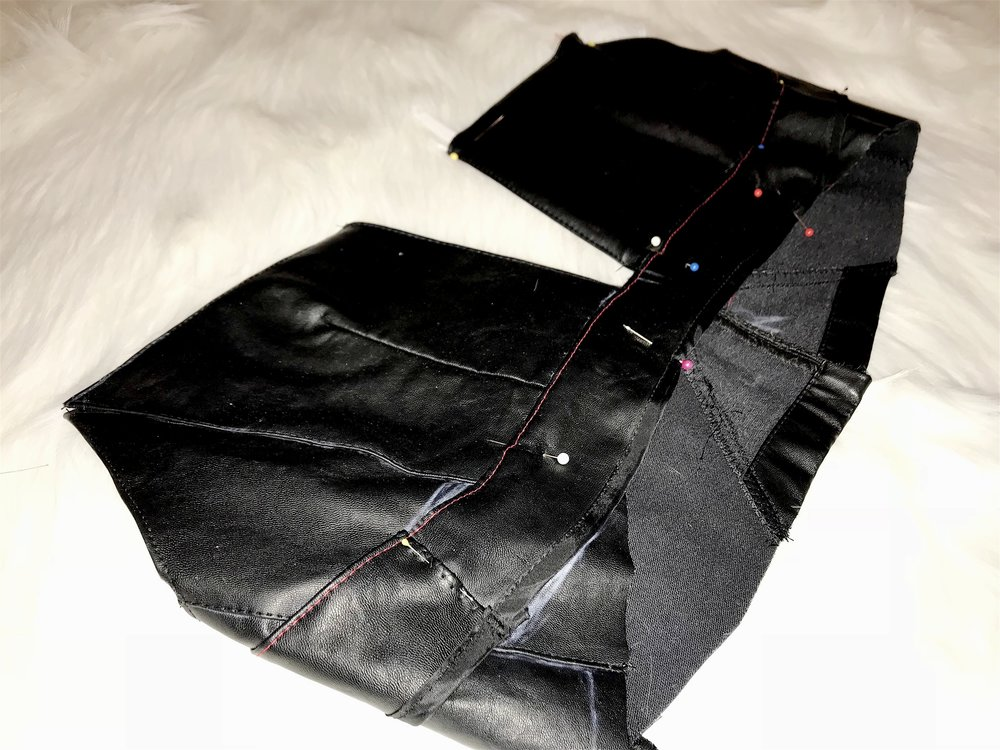 A leather top repurposed from a deconstructed skirt.