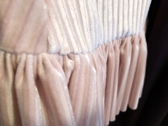 The ruffle at the bottom of a 1930's inspired skirt.