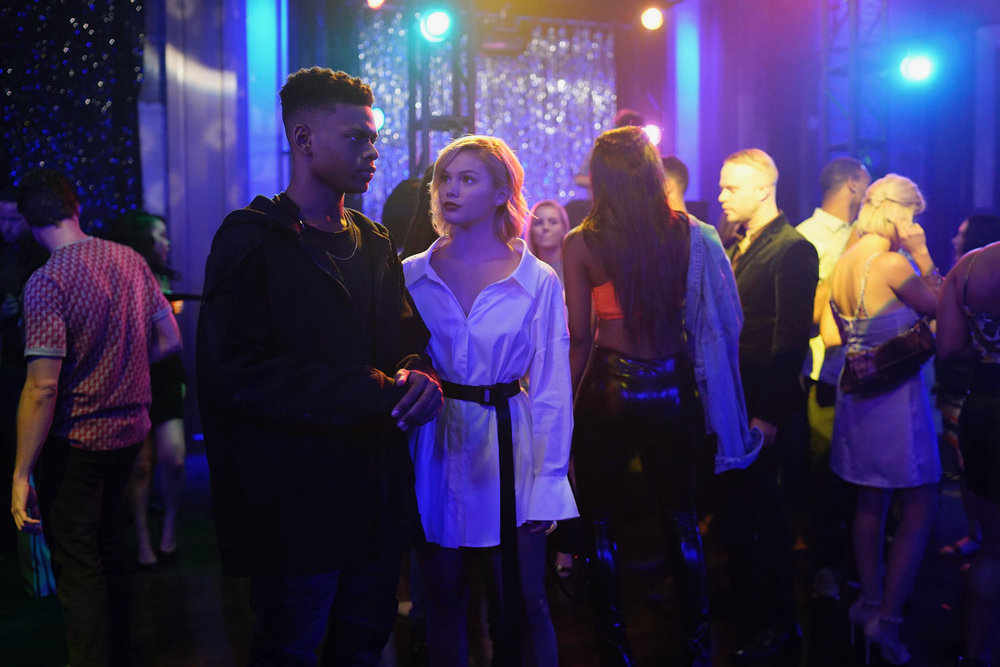 """Aubrey Joseph as Tyron, Olivia Holt as Tandy in Cloak & Dagger Season 2  Alfonso Bresciani/ ©️2018 Disney Enterprises, Inc.    """"Marvel's Cloak & Dagger"""" follows the story of Tandy Bowen (Olivia Holt) and Tyrone Johnson (Aubrey Joseph) – two teenagers from very different backgrounds, who find themselves burdened and awakened to newly acquired superpowers which are mysteriously linked to one another. The only constant in their lives is danger and each other. Tandy can emit light daggers and Tyrone has the ability to control the power of darkness. They quickly learn they are better together than apart."""