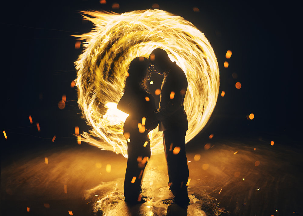 """Forged By Flame"" - A epic fine art maternity portrait created with the mother and father. I used a 2 second exposure and spun a custom made flame tourch to create this epic image."