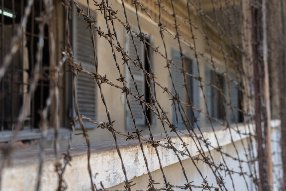 Barbwire on walls around SR-21, a former school turned into a prison