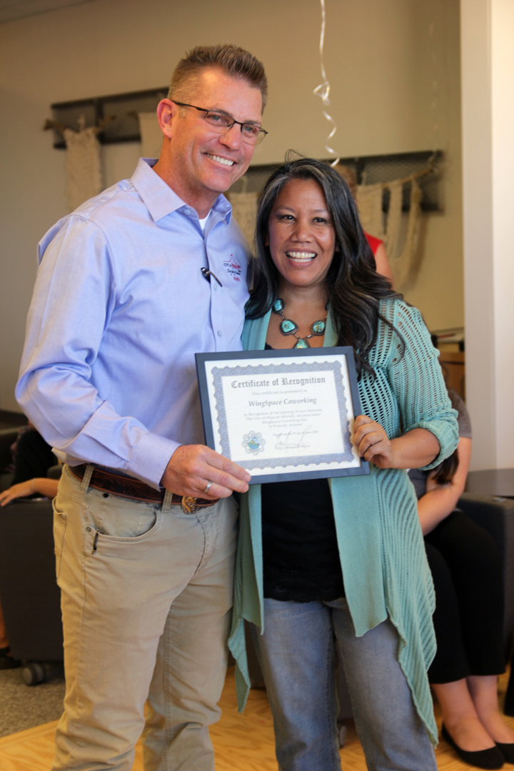 Mayor Greg Mengarelli presents Melanie Banayat with a Certificate of Recognition. The City of Prescott Declares June 7th at WingSpace Coworking Day in Prescott, Arizona.