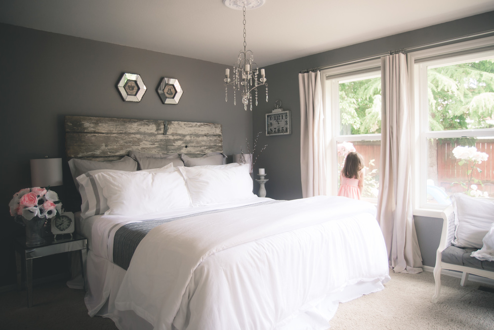 White and gray bedroom farmhouse with boll and branch