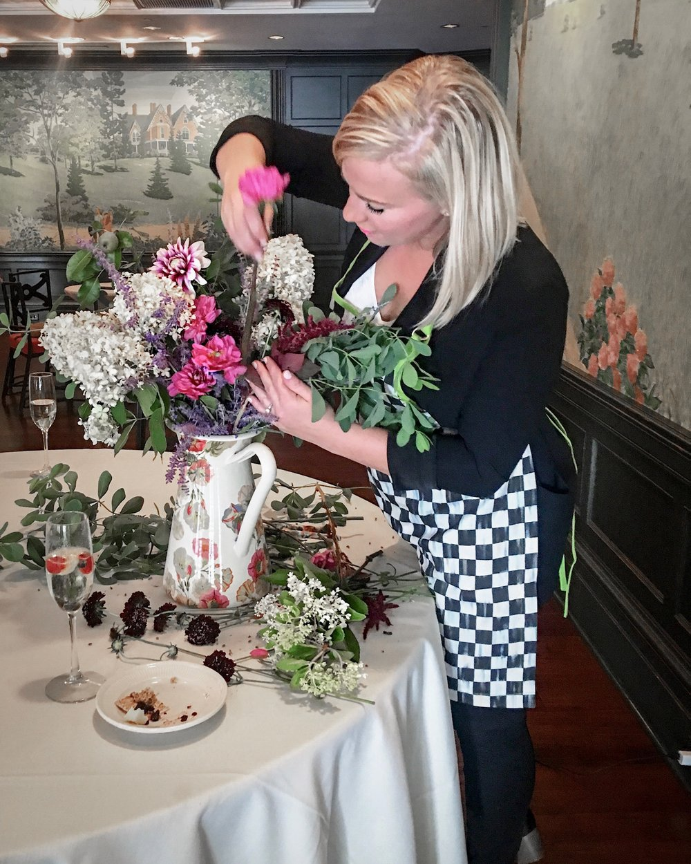 Susan is hard at work creating something beautiful (but secretly that comes really easy to her) at our floral arranging class!