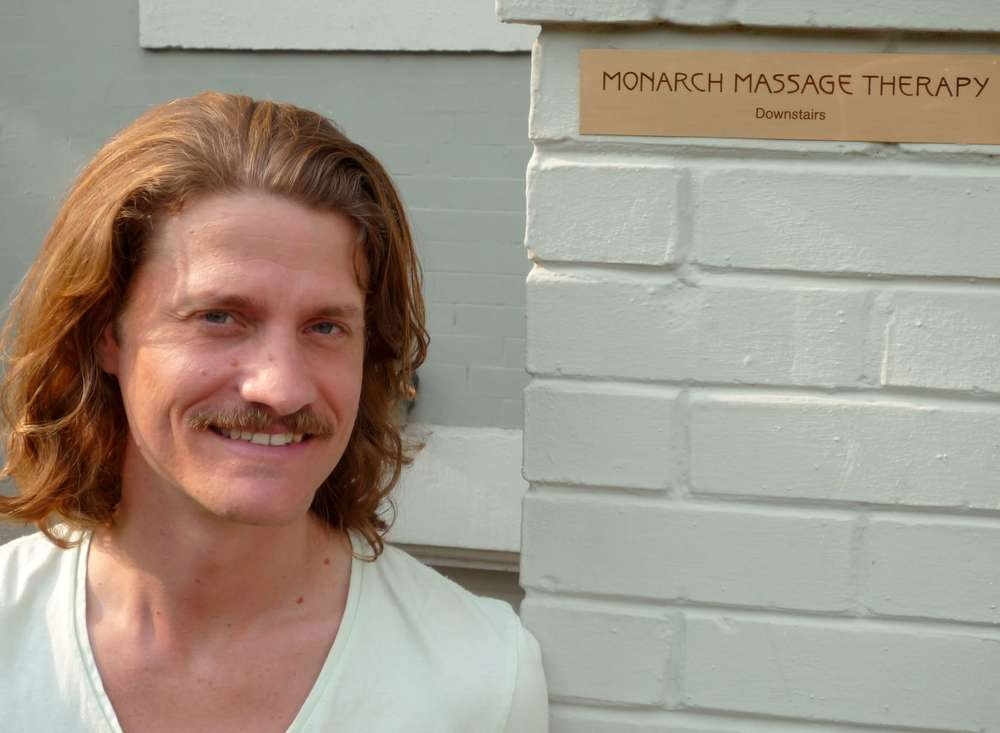 Stephen Abate standing outside his Washington DC Massage Therapy studio