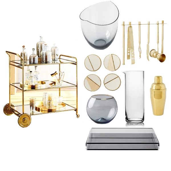 ROOST -  Florin Brass Bar Cart , OKEY LOFI -  Scandinavian Glass Ice Bucket , WEST ELM -  Deco Barware Collection , WEST ELM -  Gold Cocktail Shaker Strainer , KAUFMANN-MERCANTILE -  Japanese Glass Carafe , ALEXANDRA VON FURSTENBERG -  Voltage Cocktail Tray , ANTHROPOLOGIE -  Gilded Rim Stemless Glass , WEST ELM -  Vintage Vogue Linea Coasters