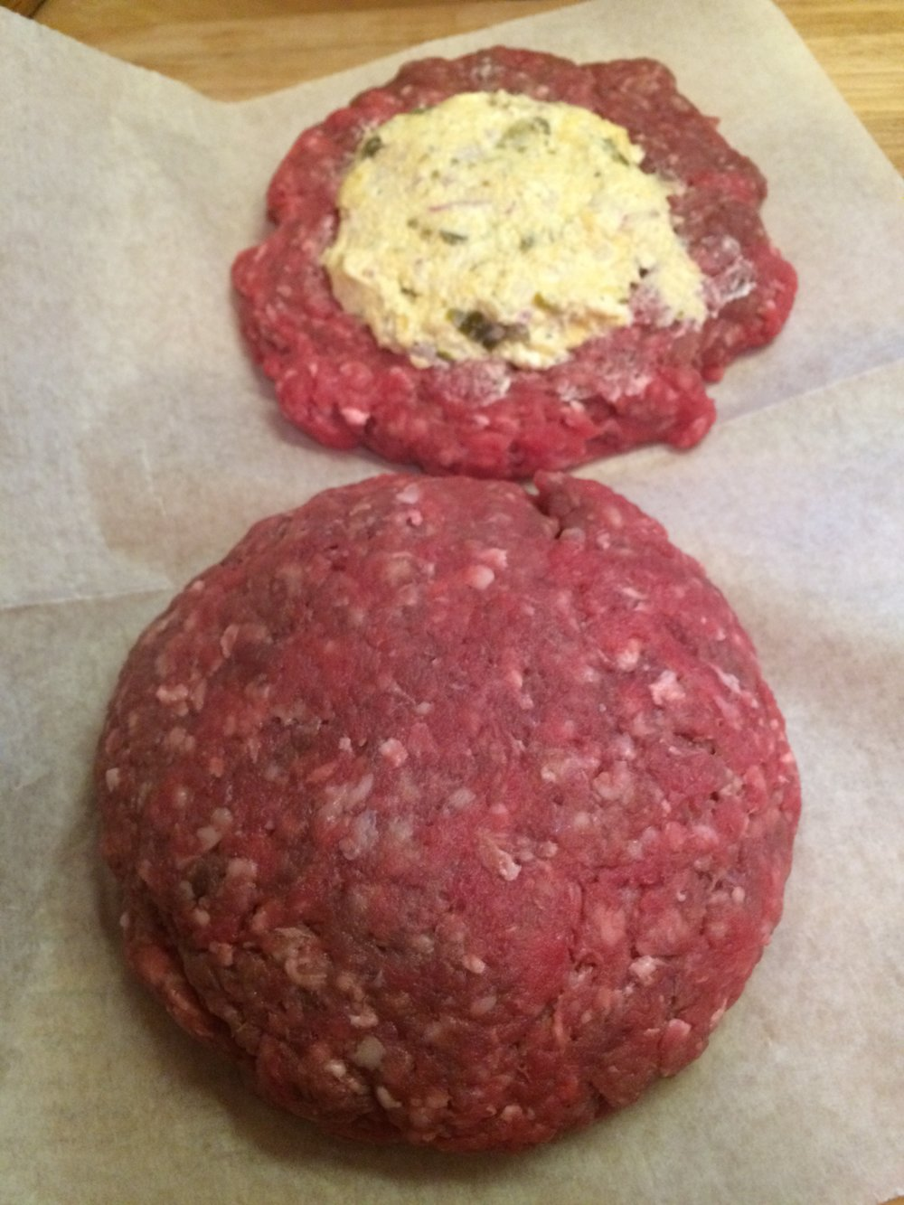 Seal the edges and reshape the burger. Sprinkle with salt and pepper before putting on the grill