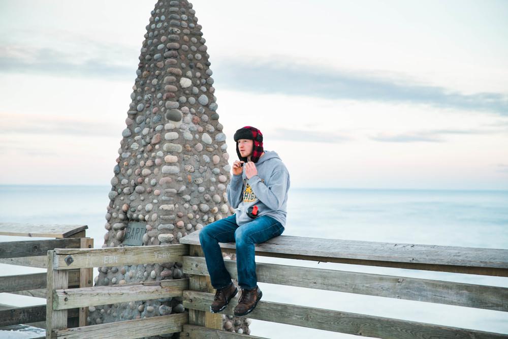 NMU sweatshirt... Plaid hat? True Yooper.