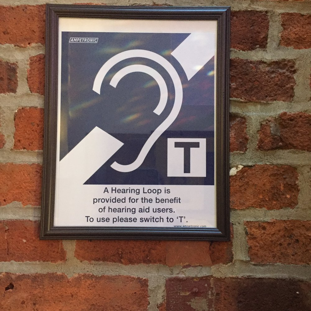 Sign indicating my church has a hearing loop installed. This means I can understand the homilies! Yay!