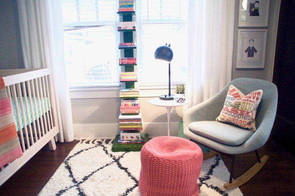 lamp  |  rocker  |  side table  |  rug  | pouf ( similar ) |  plant  |  crib  |  blanket  |  sheets  | bookshelf ( similar ) |   architect prints