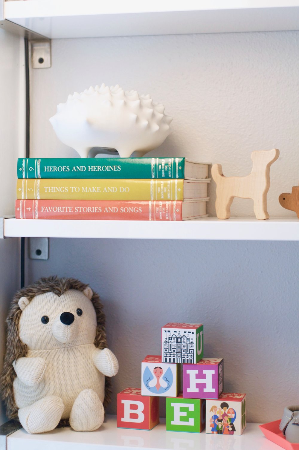 blocks  |  shelves  |  hedgehog stuffie  |  dog rattle  | books (vintage) | porcelain hedgehog (old Jonathan Adler find)