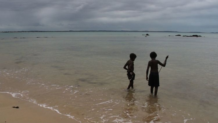 Still from Yolngu Homeland of two Yolngu boys fishing on Country.