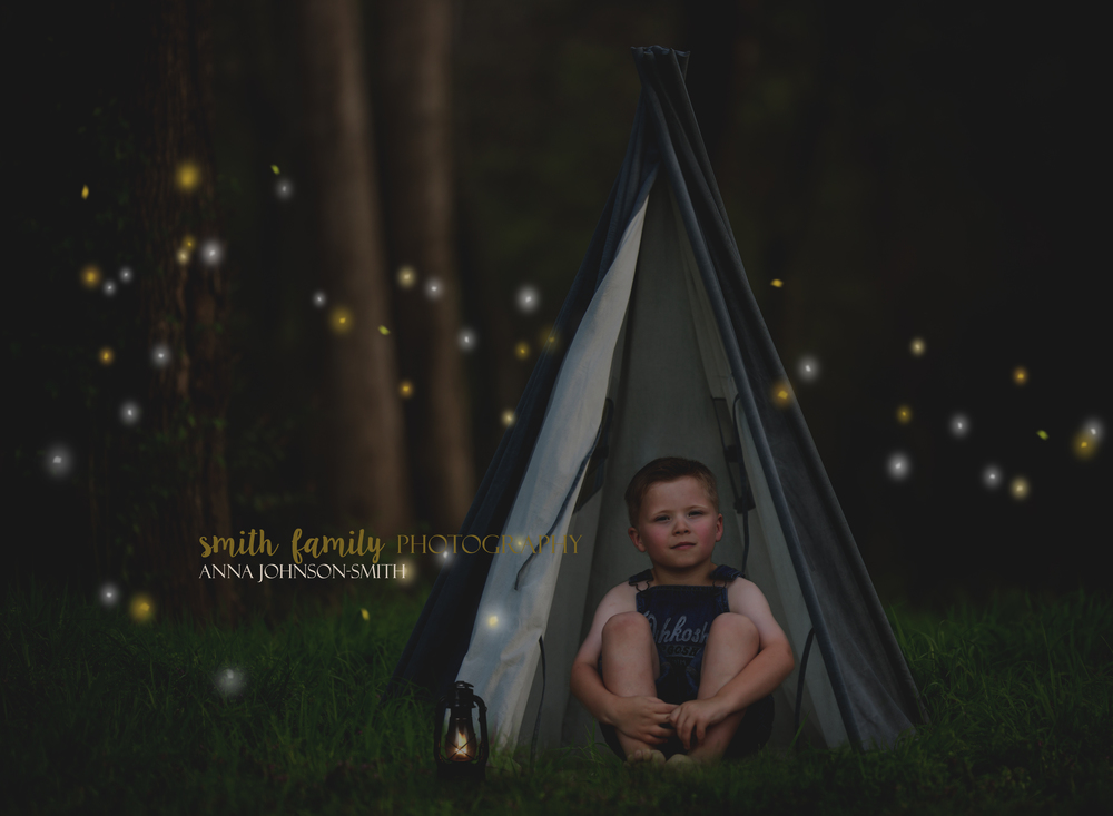 Huck Finn camping among the fireflies