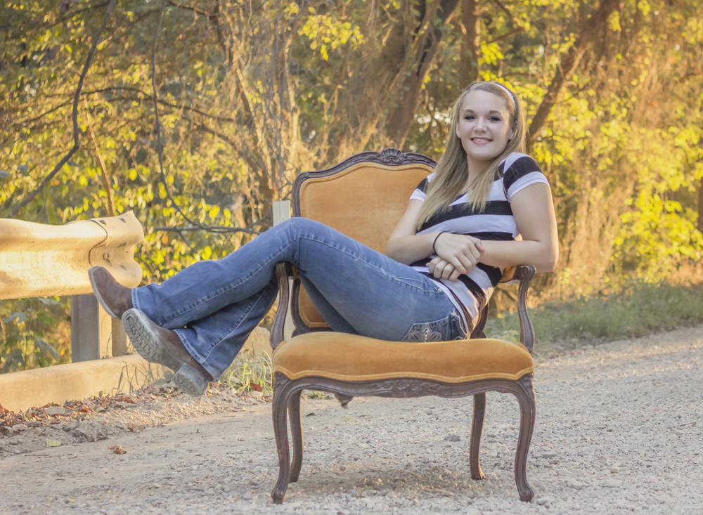 Sadie using the vintage orange chair during her session