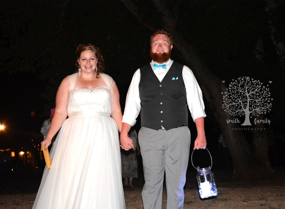 Kia and Madison used several different types of lights to create a romantic mood for their wedding reception.  My favorite was Madison carrying a lantern to the boat dock to light the path for him and his beautiful bride, Kia, so they could ride a boat down the Brazos River.  Photo credit:  Amber Payne for Smith Family Photography