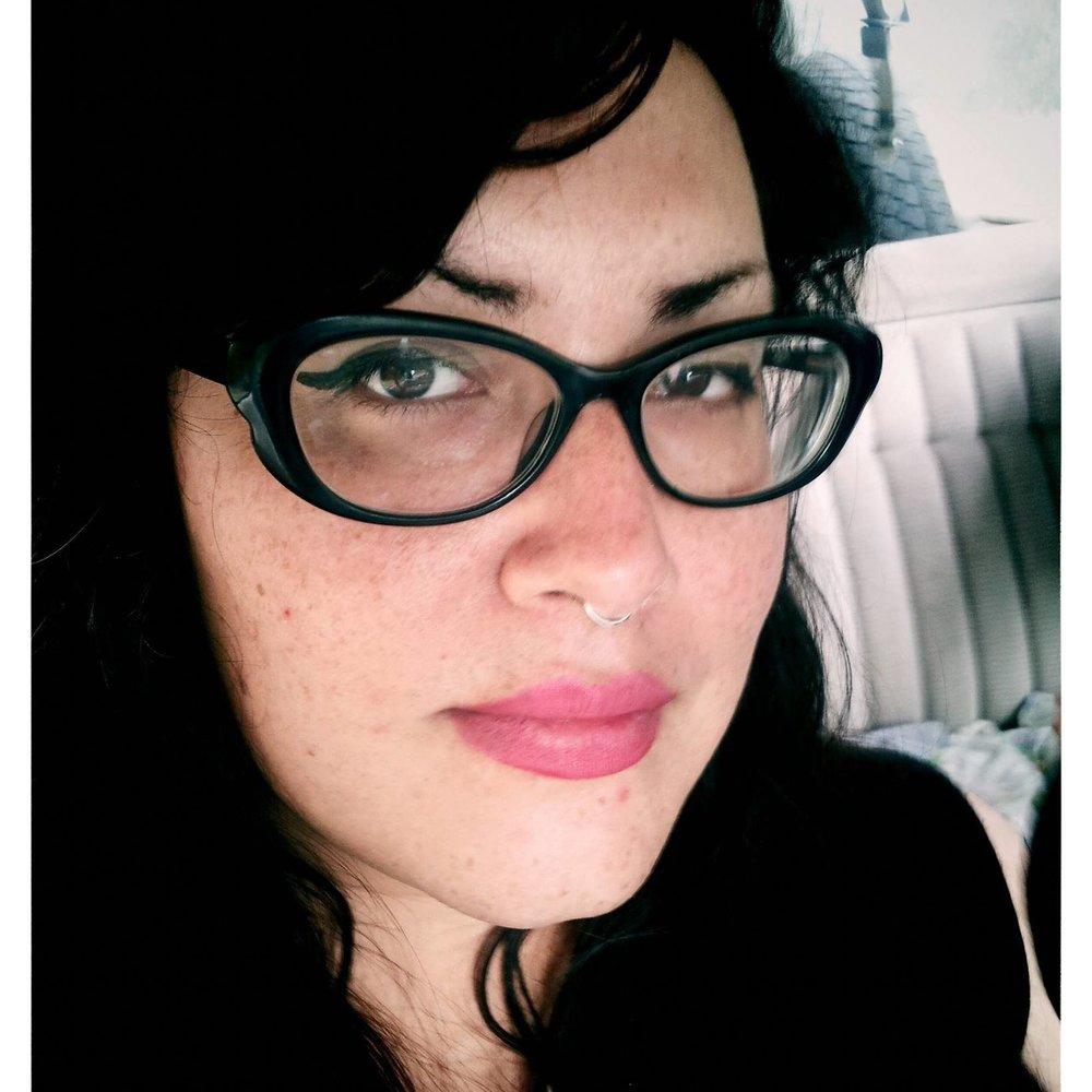 Stephanie Adams-Santos is a Guatemalan-American writer, educator and tarot reader based in Portland, OR.