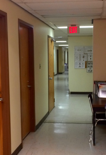 Head to the end of this hallway. Look for our lab (C202) at the stairs on the left.