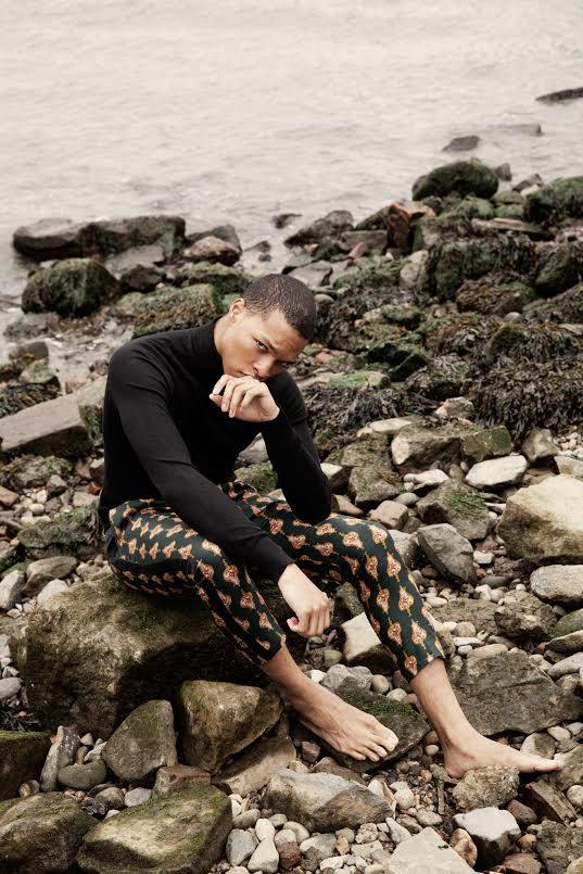 Scott Camaran wears black turtleneck; Zara Collection. Emerald tuxedo trousers; Sergio Wonder.
