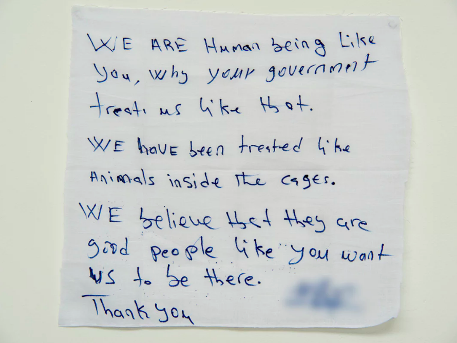 'We are human being like you, why your government treats us like that':  a message from a detainee on Manus Island .  Photograph: David T Young/ Penny Ryan