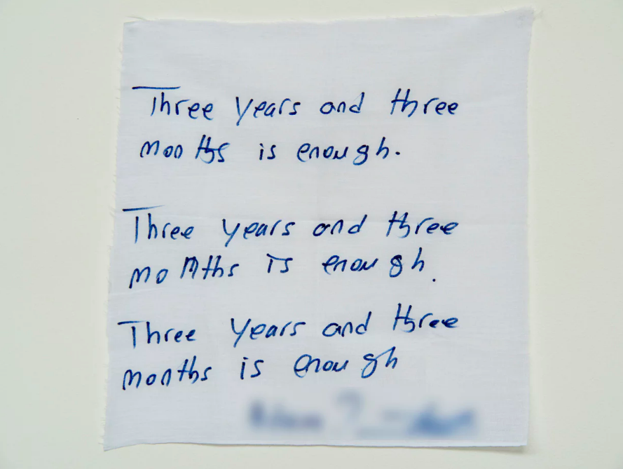 'Three years and three months is enough': a handwritten note from a detainee on Manus Island. Photograph: David T Young/Penny Ryan
