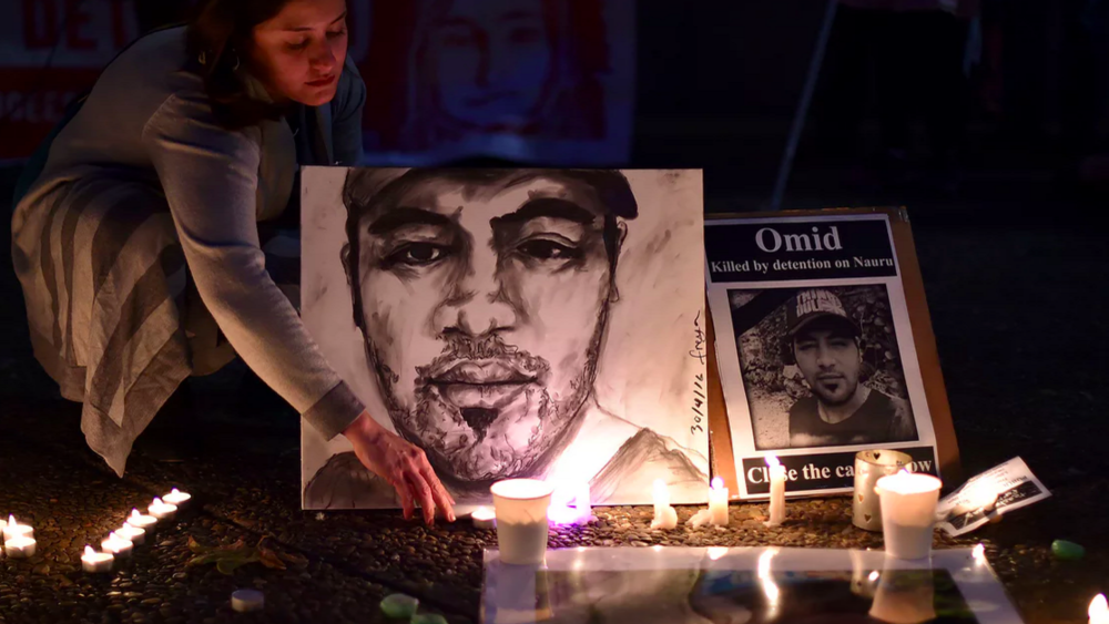 A vigil for Omid Masoumali in Sydney. Photograph: Saeed Khan/AFP/Getty Images