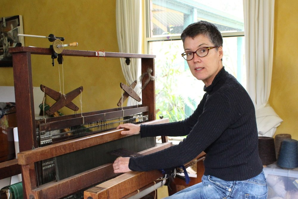 In the studio, weaving on my War Widows' Craft Guild loom.