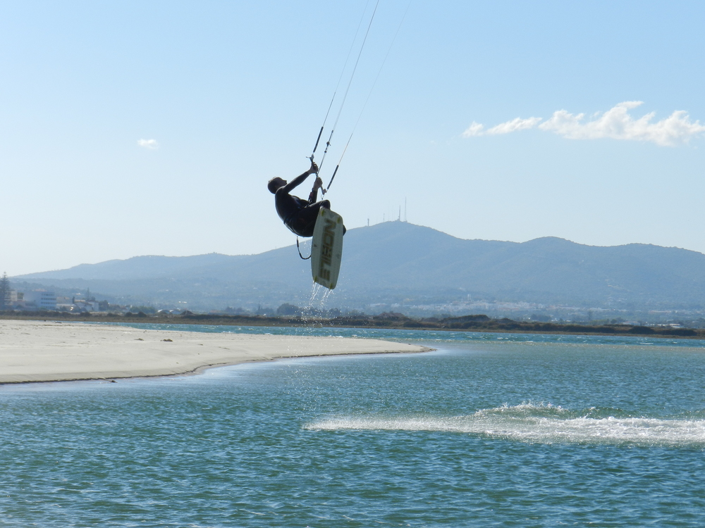 Kitesurfer getting some air in the Fuseta lagoon