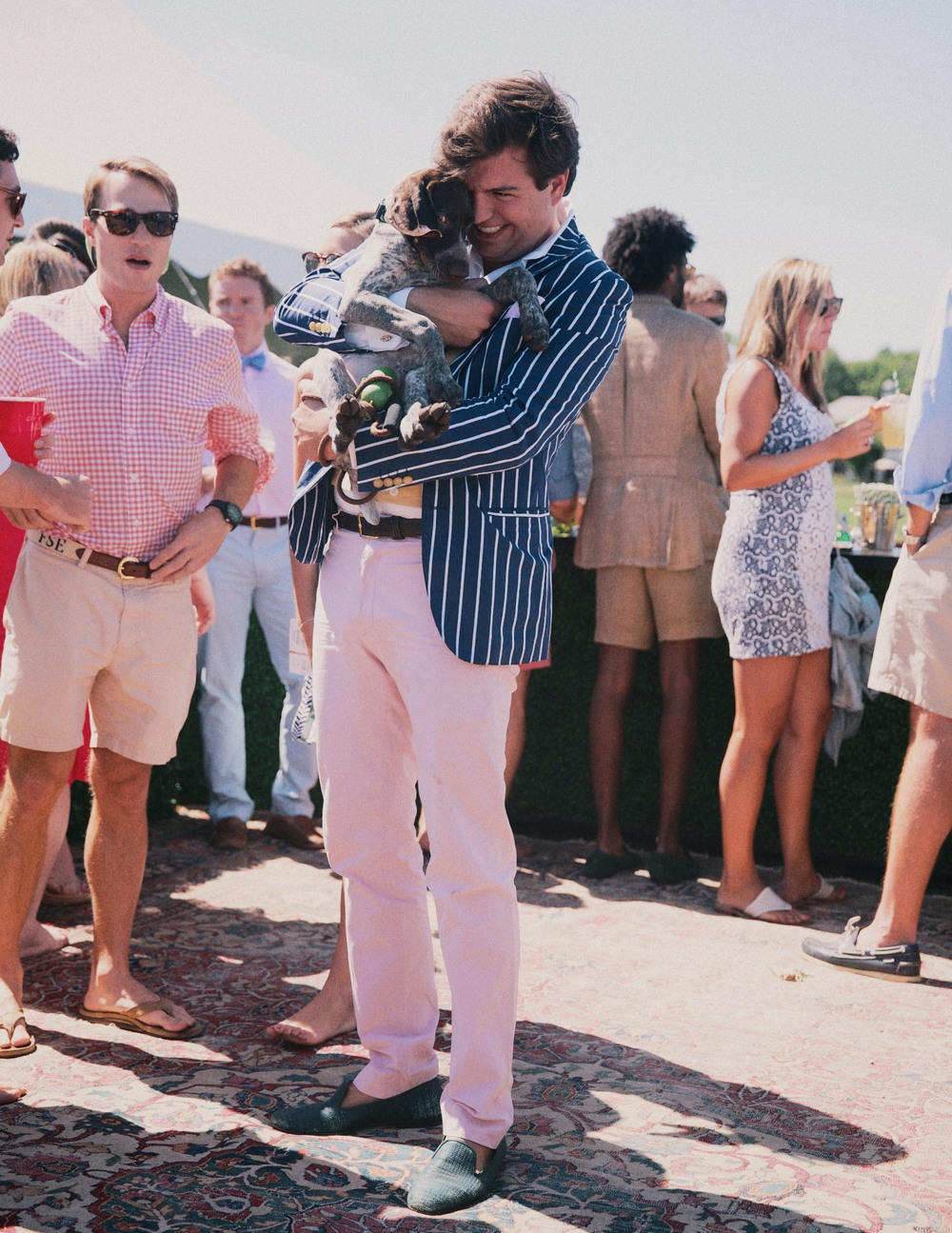 "Max Sinsteden—Harriman Cup regular—nuzzling Otis (awarded ""Best Dog"") at his Party Carpet Tailgate (awarded ""Best Tailgate"")."