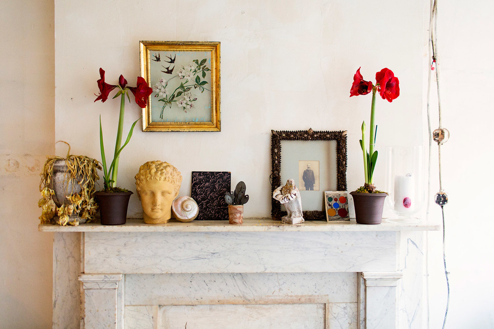 Signature John Derian style on one marble mantle—masculine and feminine all at once.
