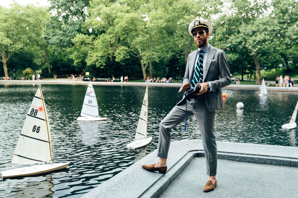 Brendan, at Central Park's Conservatory Pond, sailing some kid's boat that he stole the remote from.