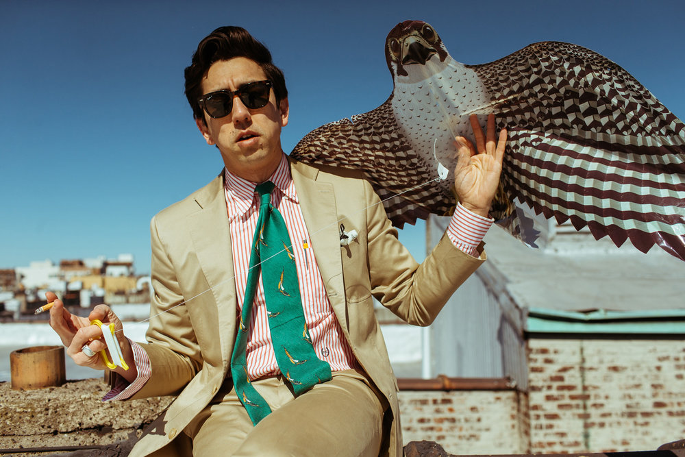 Fred wears  Drake's green sailing print silk and cotton tie  with our made-to-measure khaki cotton suit.